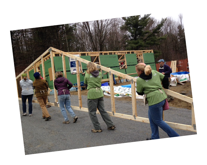 Volunteers carry trusses on a Green Mountain Habitat for Humanity worksite.