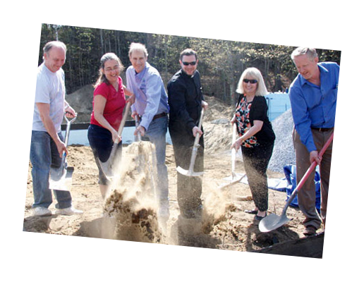 Staff and volunteers of Green Mountain Habitat for Humanity breaking ground on a worksite
