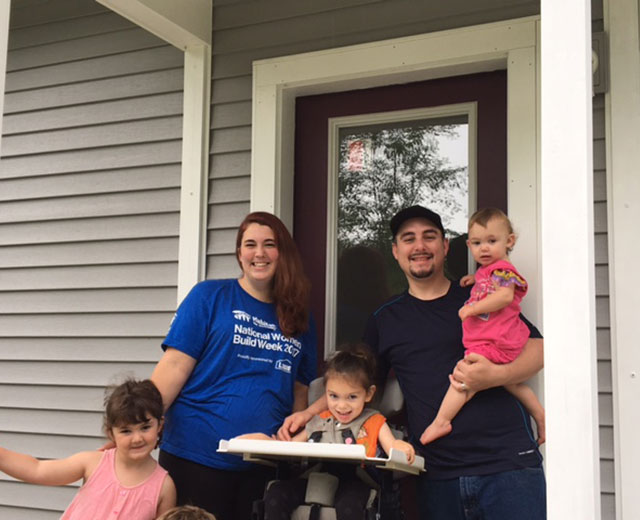 The McSweeney Family enjoying their new home, built by Green Mountain Habitat for Humanity volunteers