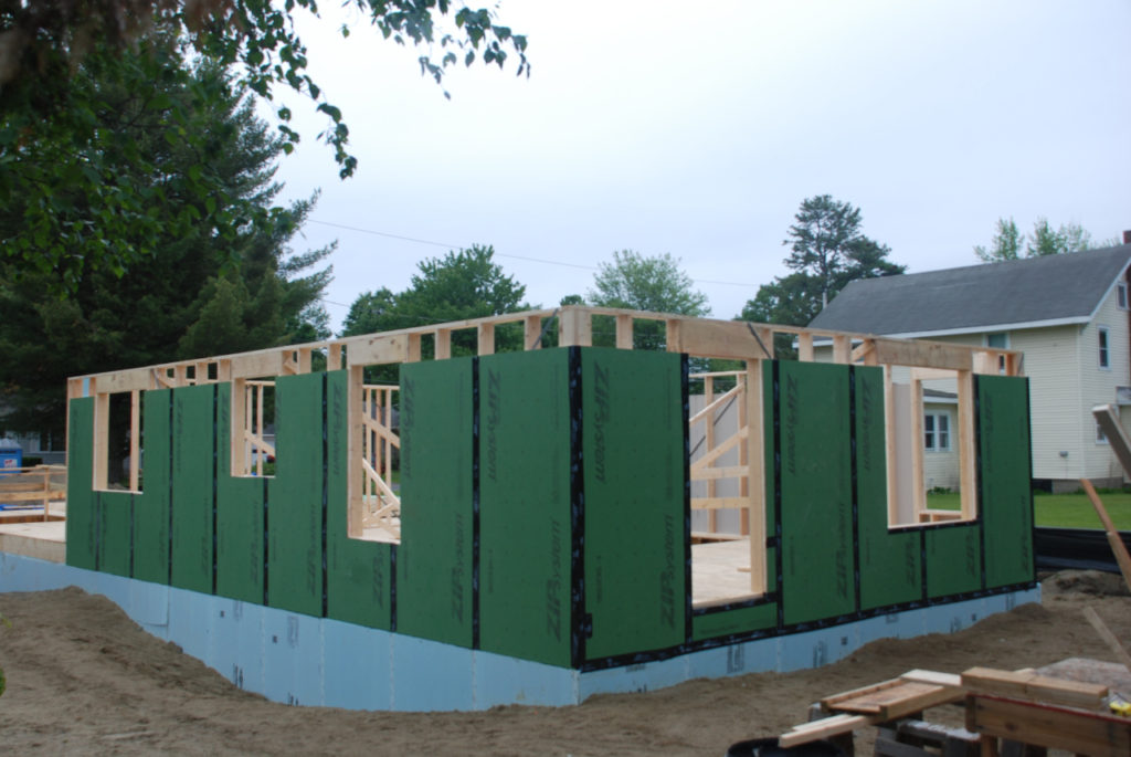 Foundation and first floor walls installed at buildsite of a new Green Mountain Habitat for Humanity home.