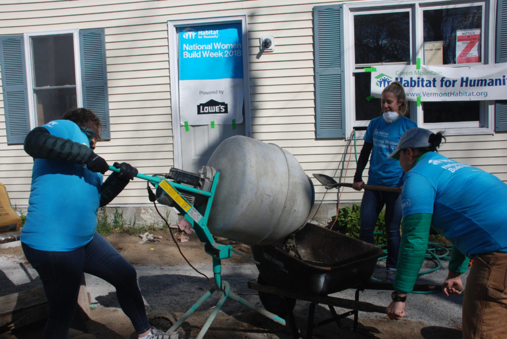 Cement mixing at Cottage Grove home, Green Mountain Habitat for Humanity