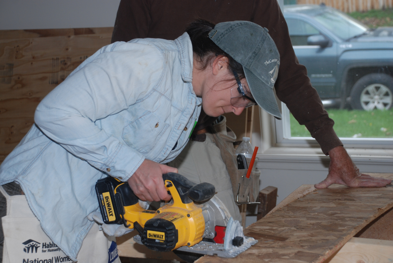 Sawing boards at Cottage Grove worksite: Green Mountain Habitat for Humanity